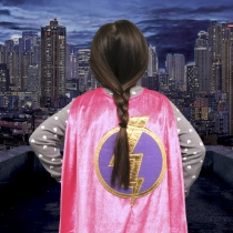 Girl superhero surveying city